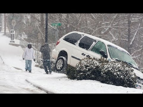 Atlanta commuters stranded in cars after snowfall