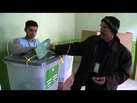 Afghans vote in historic presidential election