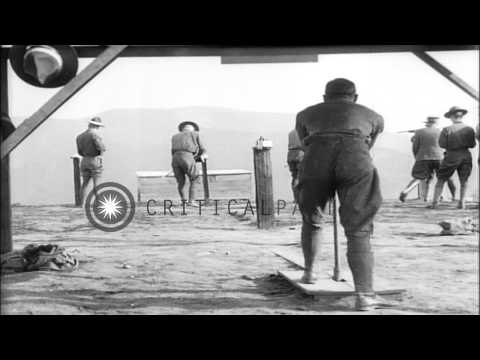 Cadets fire rifles and machine guns at target boards during World War I aviation ...HD Stock Footage