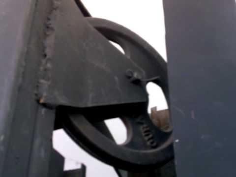 Portones levadizos automaticos Gural, poleas, unicas190mm.de hierro con ruleman.