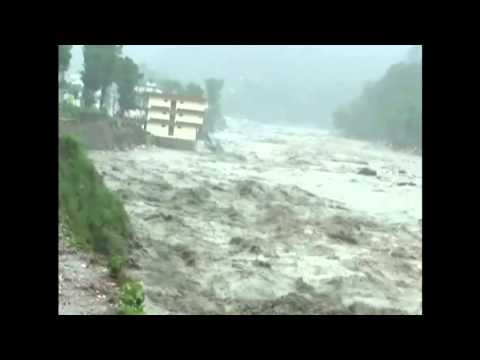 India monsoon: torrential rains washes away apartment block
