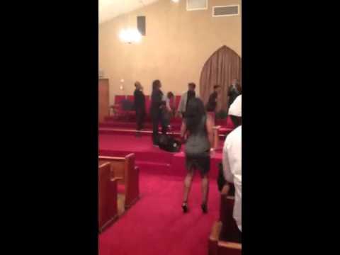 Neffe giving God praise at leandria's church