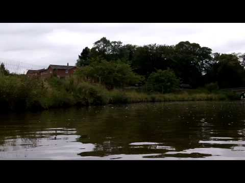 Me in my Kayak on the Macclesfield Canal overtaking boat 1080p kodak playsport