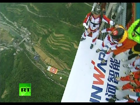 Amazing base-jumping video: Man in wheelchair 'leaps off' bridge in China