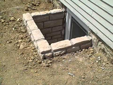 custom stone egress window wells youtube