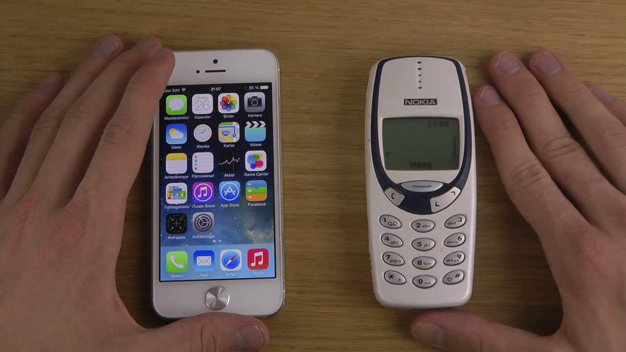 nokia 3310 vs  iphone 5 ios 7 beta 2