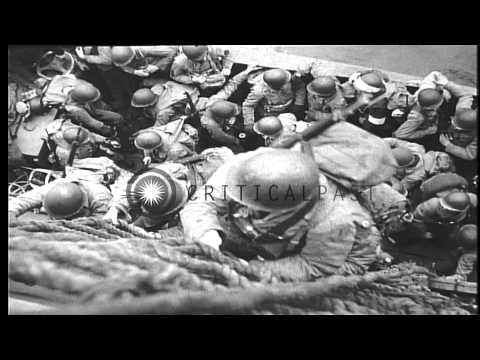 United States troops disembarking from ship to an invasion barge and land at a be...HD Stock Footage