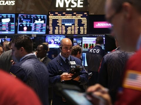 Stocks dip despite signs of economic growth