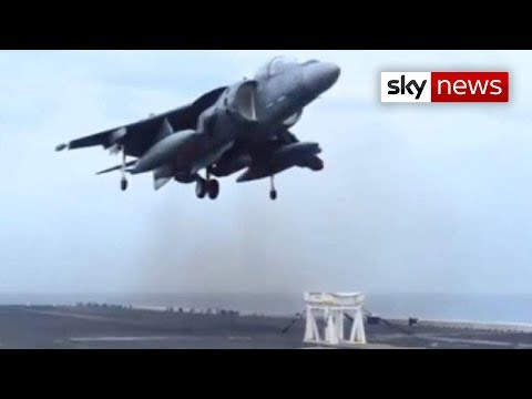 US Navy Harrier Jet Lands On Stool