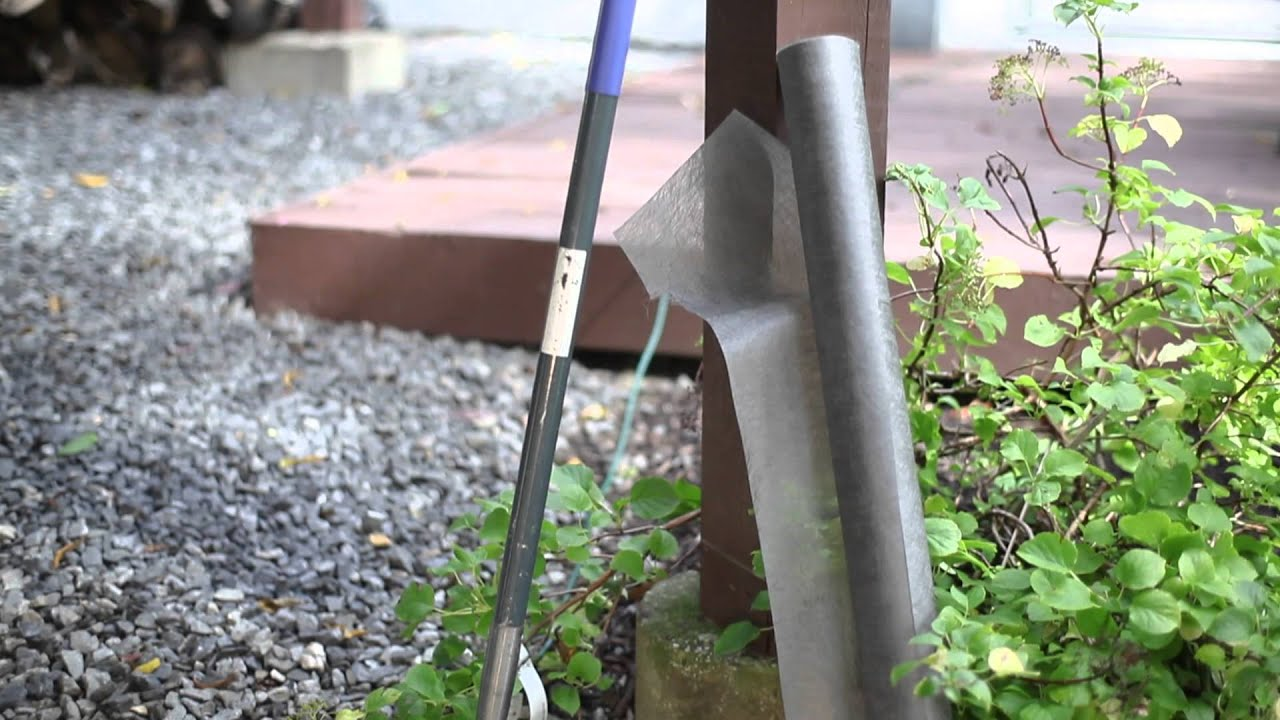 How to lay fabric for landscaping using rock beautiful for Laying river rock