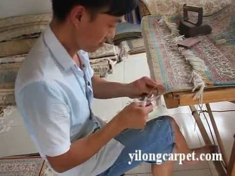 Finishing of oriental handmade silk Persian carpet