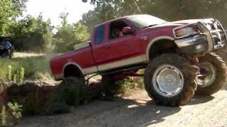 HUGE MUD TRUCKS FLEXING ACROSS GIANT RUTS Silverado