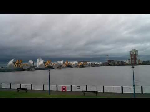 Thames Barrier closing in time lapse, and water flows into park.