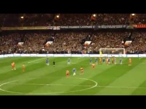 Drogba sends his free kick to the