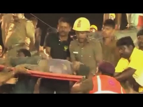 More than 130 trapped in rubble of collapsed India building