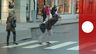 Walkin' in the Wind: People Blown Around in Streets as Storm Ivar Hits Norway