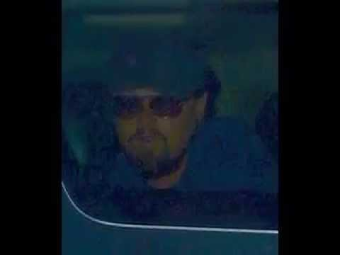 DiCaprio was seen whispering something in Cleary's ear at the club; he was also seen holding what ap