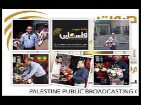 باقة ورد/محمد ابو ظاهر - الدفاع المدنى مع الموظفة مينا أبو حطب