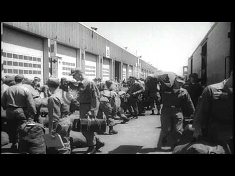 The United States troops embark a ship for Southeast Asia in California. HD Stock Footage