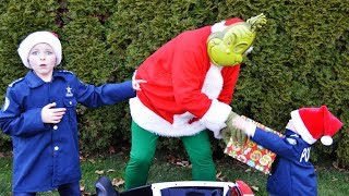 The fake present featuring Grinch holiday Christmas ruined by silly funny kids video