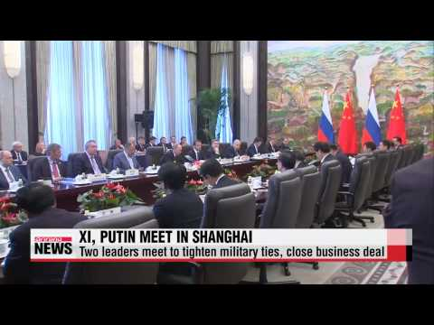 Russia, China pledge closer ties as joint military drills begin