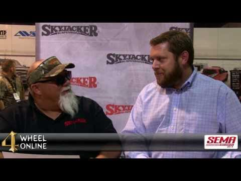 John Godwin of Duck Dynasty at the Skyjacker booth - SEMA 2013