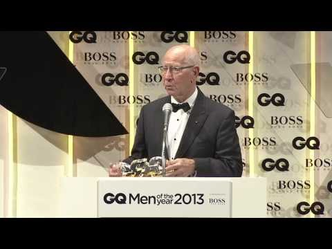 Sir Bobby Charlton collects his GQ Lifetime Achievement Award from Rio Ferdinand