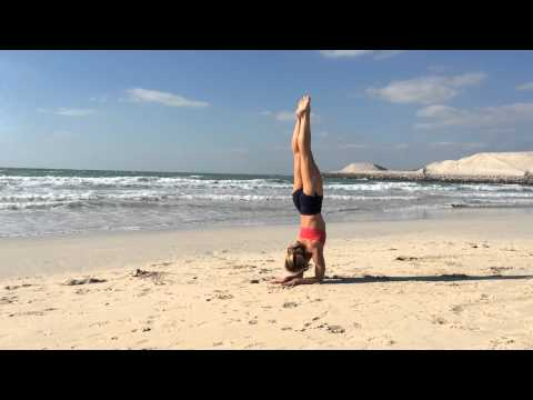 Yoga Dubai Pinchamayurasana on the Beach with Kino