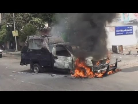 Police cars set on fire during protests in Egypt