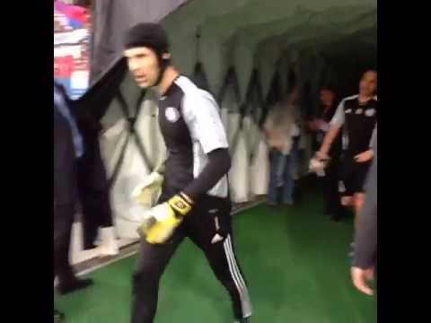 Petr Cech emerges to warm up.