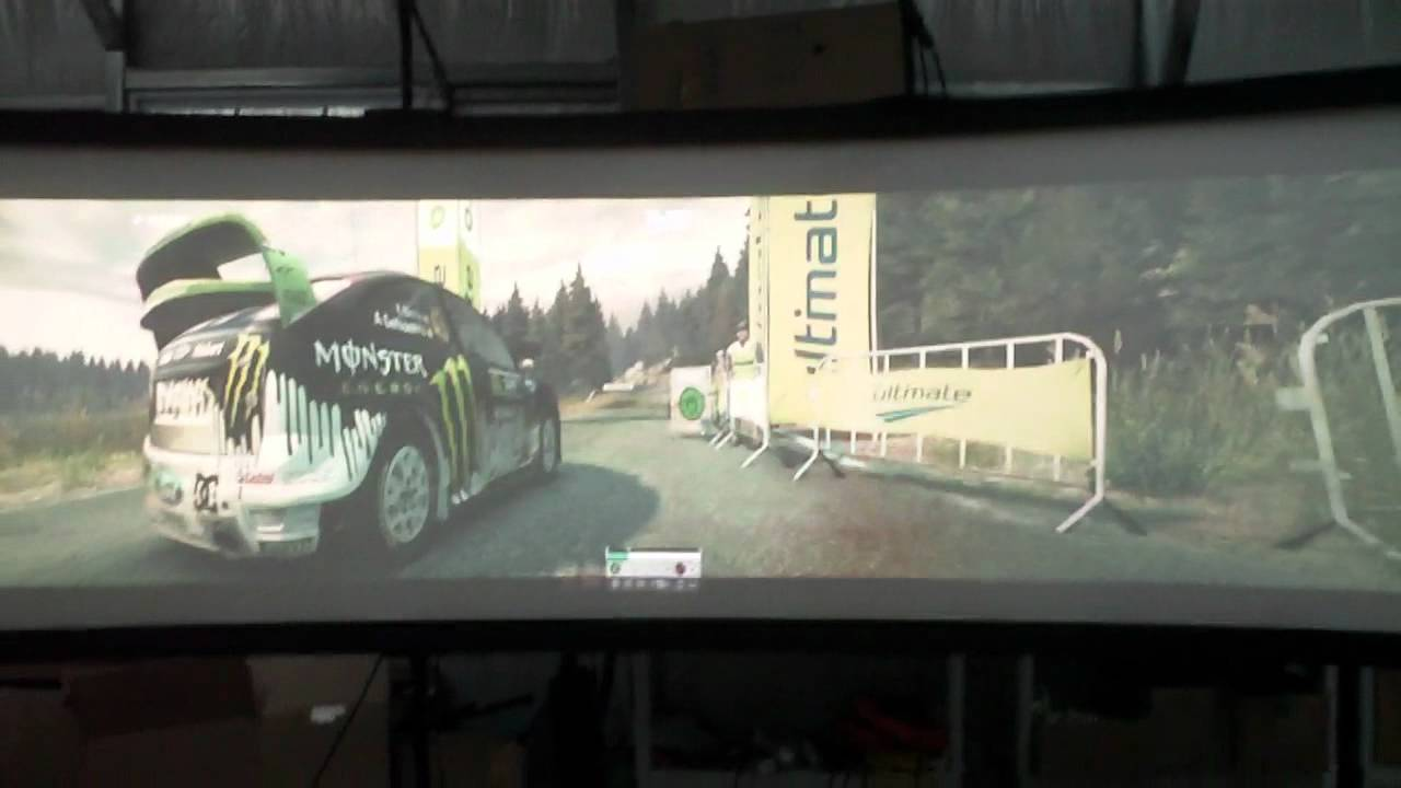 Huge curved projection video game screen on a 3 projector edge blended