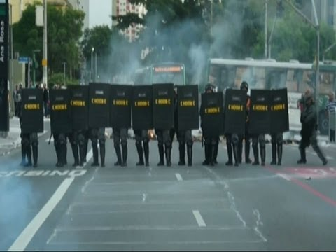 Raw: Police Fire Tear Gas During Brazil Protest