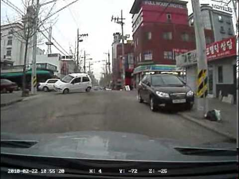 Dash cam captures roll over accident at intersection