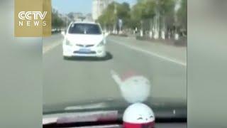 Footage: Man held in custody for driving backwards