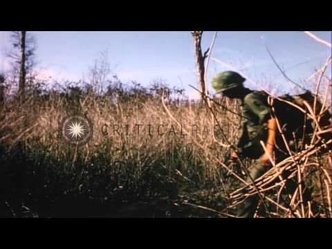US Soldiers walk to helicopter landing zone during Operation Big Spring in North ...HD Stock Footage