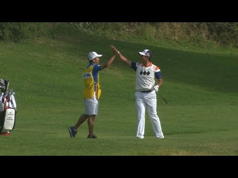 Hideki Matsuyama attacks the flag for an eagle two at Northern Trust