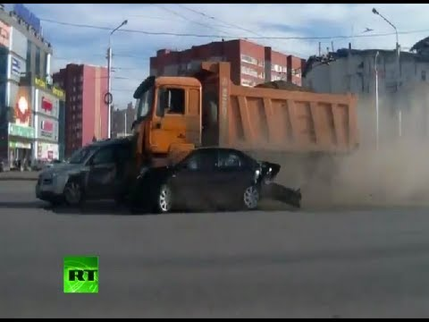 Truck rams 12 cars at full speed