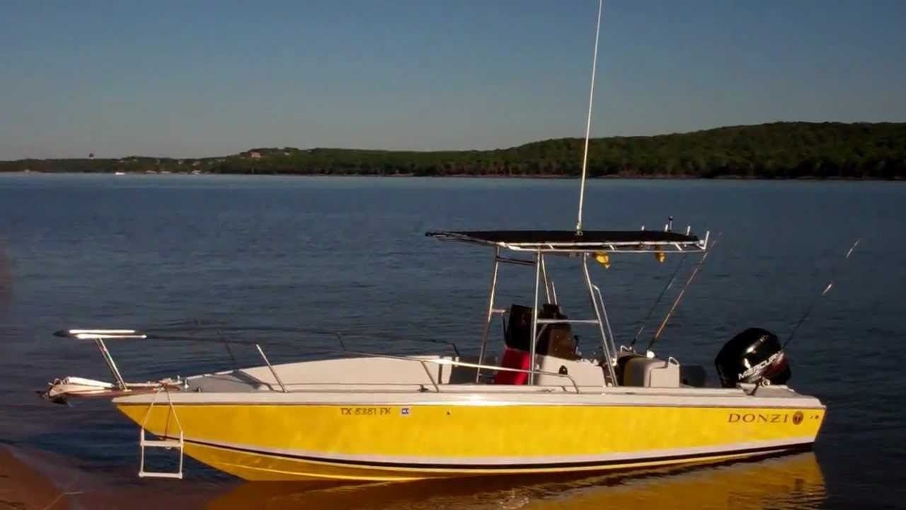 1988 donzi 23 39 center console fishing boat at rest on lake for Donzi fishing boats