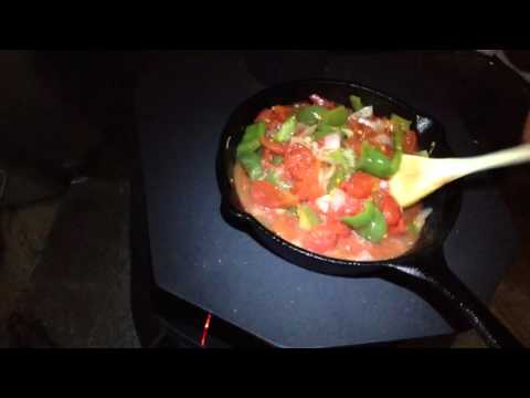 Cooking a piperade at the camp