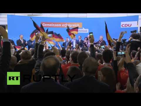 Germany: Giddy Merkel shakes a leg in celebration