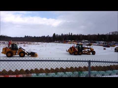 Caterpillar Equipment clearing Snowmobile Race Track