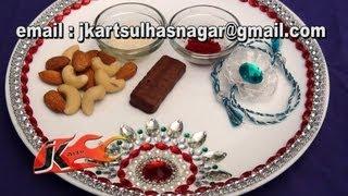 043 How to make Raksha Bandhan Thali - Style 1- JK Arts view on youtube.com tube online.