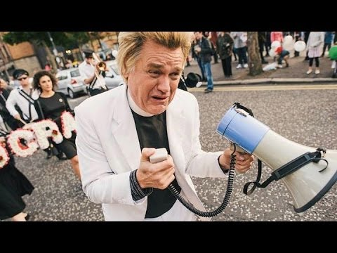 Activist Reverend Billy Charged With Rioting