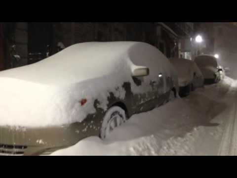 Crews work to clear snow-packed sidewalks, roads in Boston