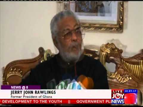 Ex - President John Rawlings signs Mandela's Book of condolence