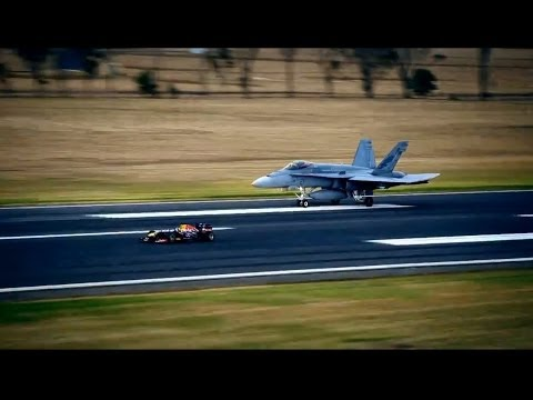 Daniel Ricciardo faces off against an F/A-18 Hornet