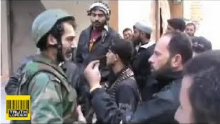"Syrian soldier Mustafa Shaddoud puts down rifle to talk to his FSA ""brothers"""