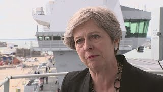 Theresa May criticises Trump for his failure to condemn white supremacists