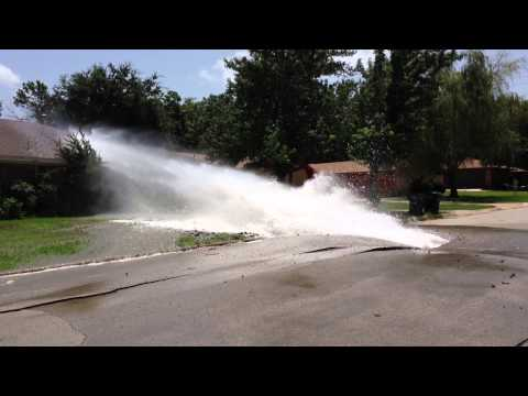 Water main bust tears up neighbor's house