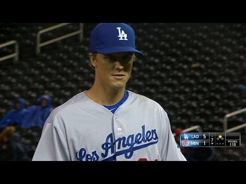 Greinke allows one unearned run, goes to 5-0